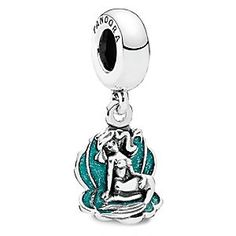 Ariel Charm by PANDORA | Disney Store The Little Mermaid rests her weary tail as she nestles in the sterling silver shell of this Ariel charm. Created by PANDORA, the Disney Princess is set against the translucent backdrop of green enamel.