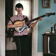 Joey Ramone, singer for....The Ramones! So cool that words can never adequately describe their contributions. Here's Joey at 11 or 12 with a Sears Silvertone guitar.
