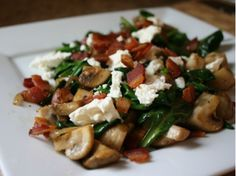 A warm wilted spinach salad, topped with caramelized mushrooms, salty feta, and crispy bacon!