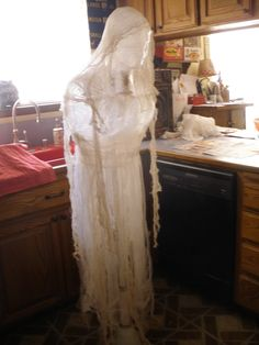 Packing tape/cheesecloth ghost to hang in trees. Done for under 10 bucks…