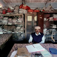 "Bureaucrats from Around the World. India: Surinder Kumar Mandal (b. 1946) is circle inspector of taxes in Thakurganj block, collecting taxes in a specific part of Kishanganj district, State of Bihar. Monthly salary: 9,500 rupees ($ 208, 189 euro). Surinder Kumar Mandal (b. 1946) is ""circle inspector"" van belastingen in Thakurganj Block, Kishanganj district, State of Bihar. Maandsalaris: 9,500 rupees (euro 189, US$ 208)."