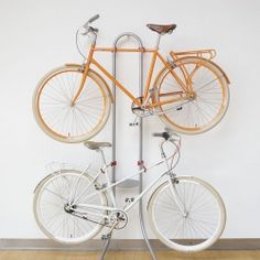 This bike stand from Public allows vertical storage without any holes. Just lean the stand against the wall, and gravity does the rest.