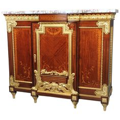 Rare Late 19th Century Gilt Bronze Mounted Marquetry Cabinet | From a unique collection of antique and modern cabinets at https://www.1stdibs.com/furniture/storage-case-pieces/cabinets/