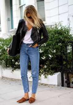 Blue jeans, white tee, black moto, leopard mules.