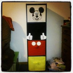 Cheap Bookcase and coloured bins from boring to Mickey........oooooh my next project.....file cabinet!!!