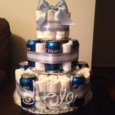 DIY beer  diaper cake! I used 64 size 2 diapers and 12 cans. Super easy and perfect for a co-ed beer  diapers shower! Cans can always be substituted for more diapers or baby bottles. #huggiesforchuggies #diapercake