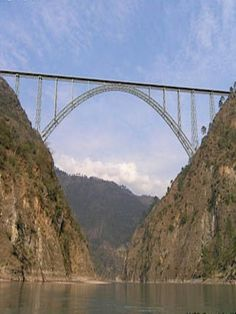 Chenab railway bridge will be the tallest in the world when completed.  It is located between Bakkal and Kauri in the Kashmire, India.  The 1,315 m-long bridge is being built at a height of 359 m.