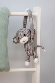 This is a DOWNLOADABLE PDF pattern with all the instructions you need to create an adorable cheeky monkey that can be used to tie back curtains in a nursery.
