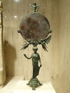 Ancient Greek mirror, bronze, said to be from an Etruscan tomb, 465-450 BCE.     Photo taken by Daderot at the Nelson-Atkins Museum of Art, Kansas City, Missouri, USA.