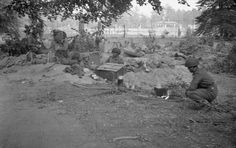 OPERATION 'MARKET GARDEN' - THE BATTLE FOR ARNHEM, SEPTEMBER 1944/ Troops take advantage of a lull in the fighting to prepare a hasty meal.  © IWM (BU 1114)