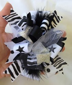 Black and white hair bow with zebra and stars ribbon