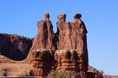 A closer view of the famous rock formation called The Three Gossips from The Courthouse Towers Viewpoint in Arches National Park in Utah.