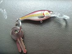 For men! Take an old fishing lure and turn it into a key chain. Just take the hooks off and boom. Instant key chain.
