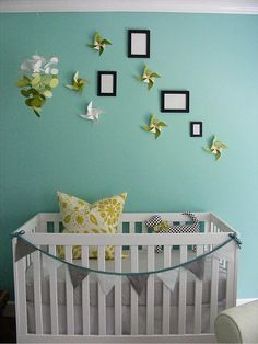 This nursery is so cute with the little pinwheels - from e tells tales
