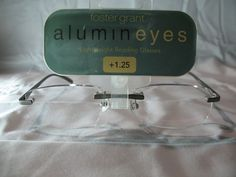 5f86f50b91b Foster Grant Alumineyes Gray Rimless Rectangular Reading Glasses +1.00 1.25