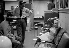 Candid photo of Illinois State Troopers and Marilyn Mondroe. Marilyn's flight was delayed by bad weather at Chicago Midway Airport in 1955.