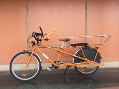 Orange Mundo from Yuba with Yepp front mount seat and Monkey bars on the back