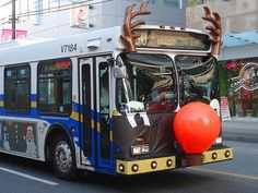 A city bus in Vancouver gets decked out as Rudolph the Red-Nose Reindeer for the holidays. The nose blinks on and off  :-)