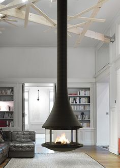 Modern fireplace: find a modern fireplace in our collection, heat and decorate your living room with a modern fireplace. Find a modern fireplace or a free standing wood stove among the large range of JC Bordelet contemporary fireplaces and stoves. Suspended Fireplace, Floating Fireplace, Hanging Fireplace, Wood Fireplace, Modern Fireplace, Fireplace Design, Fireplace Ideas, Free Standing Wood Stove, Fireplaces Uk