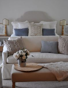 I like the pillow arrangement on the bed and the cozy loveseat at its foot!