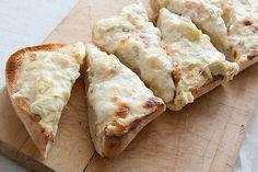 Artichoke Bread  http://www.crumbblog.com/2011/09/secret-recipe-club-1-killer-artichoke-bread.html