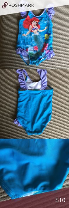 Toddler Ariel bathing suit Size 2T Ariel bathing suit. Very good condition. A couple of small picks on the rear shown in pictures. Disney Swim One Piece