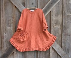 Heavy linen tunic with a money-bag pocket in rich rusty orange; an original design from Bonnie Harris of LinenClothing.