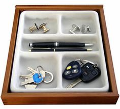 Tidy up your cluttered jewelry and other small personal items with a Stack -Em Wood Valet Jewelry Organizer.  This jewelry storage tray offers five compartments of storage for everything from earrings and cuff links to your car keys and favorite watch and has a space-saving stackable design perfect for maximizing the s