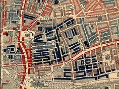 "Part of Charles Booth's poverty map showing the Old Nichol slum. Published 1889 in Life and Labour of the People in London. The red areas are ""middle class, well-to-do"", light blue areas are ""poor, 18s to 21s a week for a moderate family"", dark blue areas are ""very poor, casual, chronic want"", and black areas are the ""lowest class...occasional labourers, street sellers, loafers, criminals and semi-criminals""."
