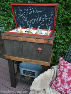 A Standing Cooler with a Chalkboard Display