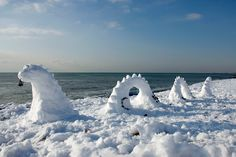 The Loch Ness Monster appears - in snow form - on Brighton Beach, Brighton, southern England, on December 18, 2009.