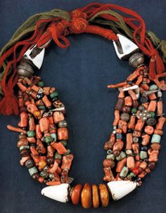 Morocco | Necklace; amber, shell, coral, amazonite, silver, glass and stone beads strong on plaited wool