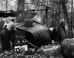 """""""Submarine"""" Moonshine Still. Another name for this still is """"black pot."""" It has a capacity of 800-gallons of """"mash."""""""