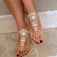 Beautiful Gold Bridal Foot Jewelry for Weddings on the Beach.Barefoot Sandals with Gold Chains and Crystals that will Glint and Sparkle on top of your feet. The Ankle Chain Is Adjustable at the Back of the Foot. This BareFoot Sandal Design will Add the Finishing Touches to a Perfect Wedding Day!