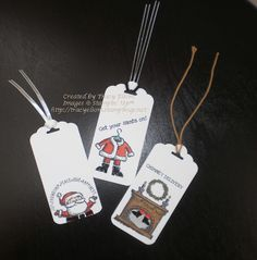 3 gift tags made using the Get Your Santa On photopolymer stamp set from the Stampin' Up!® 2014 Holiday Catalogue.  http://tracyelsom.stampinup.net