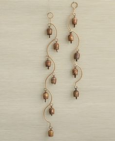Long curving wind chimes create lovely light sound with traditional Indian bells. Available in two lengths. Massage Place, Good Massage, Mobiles, San Diego, Wind Chimes Craft, Buddha Wall Art, Pooja Room Design, Mandir Design, Pooja Rooms