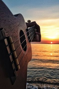 The ukulele is a very small guitar that originated from an island in Portugal called Madeira. In travelers took a ship from the island of Madeira to Hawaii. Arte Do Ukulele, Acoustic Guitar Photography, Semi Acoustic Guitar, Small Guitar, Guitar Photos, Best Guitar Players, Music Aesthetic, Music Wallpaper, Jolie Photo