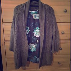 Gap Cable Knit Cardigan Sweater Dark grey cable knit cardigan. Soft cotton sweater with cropped sleeves and very warm! Looks great with everything! No flaws! GAP Sweaters Cardigans