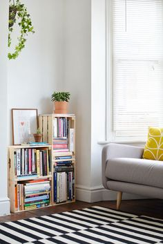 Crate bookcase, or above the toilet in the bathroom or near entry for storage
