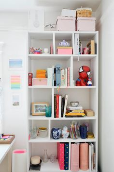 Planning Pretty - customized a Billy bookcase from Ikea by adding vertical dividers.