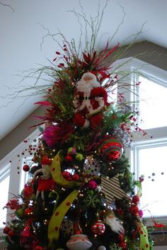 dr seuss room tree topper with santa and many variety of stems holidays