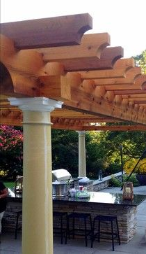 this #cedar arbor defines an outdoor kitchen space nicely