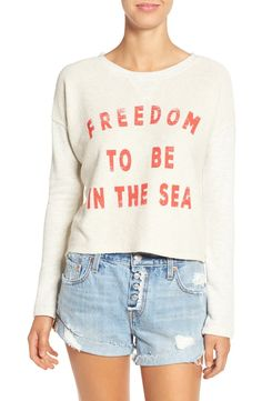 Declaring love for the sea with this terry cropped sweatshirt featuring a breezy open back.