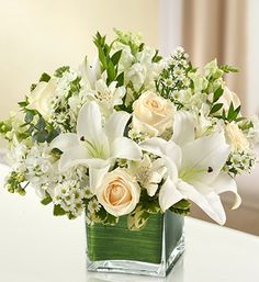 Healing Tears - All White Arrangement Elegant white flowers help to convey your love with graceful beauty that heals the soul. Our lovely cube vase arrangement is crafted from fresh roses, lilies, sna 800 Flowers, Fresh Flowers, Silk Flowers, White Flowers, Beautiful Flowers, White Roses, White Flower Arrangements, Floral Centerpieces, Wedding Centerpieces