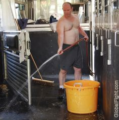 cowboy cleaning horse trailer
