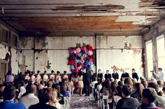 This proves that you can hold a wedding any where and your friends will show up.  Wedding Day Flower Wall via Brit + Co.