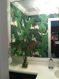 Martinique wallpaper in my powder room. Feeling like I'm at the Beverly Hills Hotel.