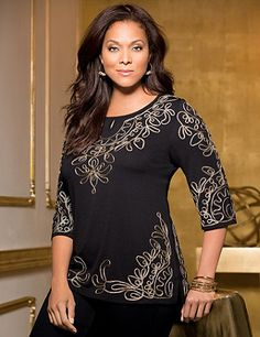 Beautifully adorned with looping soutache embroidery, our lovely top will liven up your entire outfit. Metallic stitching creates a wonderful glow that you are sure to love. Scoop neckline with keyhole detail. Three-quarter sleeves. Side slits at hem. Catherines tops are designed for the plus size woman to guarantee a flattering fit. catherines.com