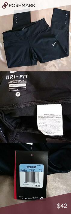 Nike epic run crop length pants Dri-fit  Inseam: 22 in. Little pocket in back with zipper Has cute ties inside front A little pocket inside front part Nike Pants