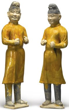 TWO LARGE AMBER-GLAZED POTTERY FIGURES OF GROOMS TANG DYNASTY